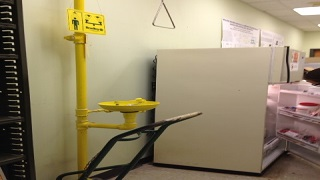 Cylinder hand truck blocking safety shower