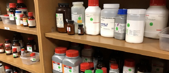 chemical bottles on a shelf
