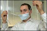 man putting on surgical mask