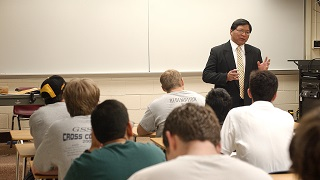 professor teaching at the front of a class