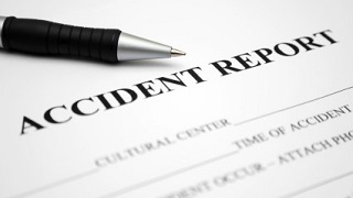 accident reporting document with pen